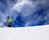 Snowboarder on off-piste slope — Stock Photo