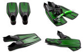 Set of green swim fins, mask, snorkel for diving with water drop — Stock Photo