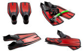 Set of red swim fins, mask, snorkel for diving with water drops — Stock Photo