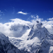Snowy mountains in sunlight clouds — Stock Photo #48143543