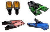 Set of multicolored swim fins, mask, snorkel for diving with wat — Stock Photo
