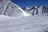Snowboarders downhill on off piste slope with newly-fallen snow — Stock Photo