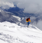 Snowboarder on off-piste slope an mountains in haze — Stock Photo