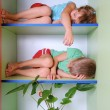 Tired kids in a closet — Stock Photo #1005882