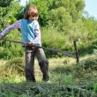 Child working with rake — Stockfoto #12724034