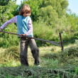 Child working with rake — Stock fotografie #12724034