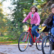 Happy children riding bikes — Stock Photo