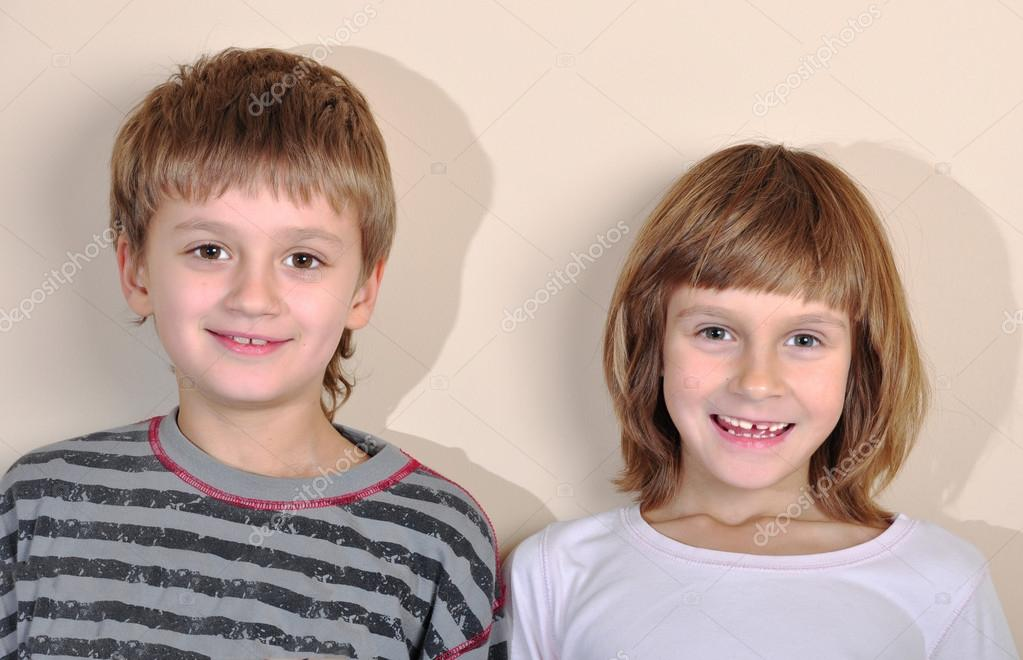 Happy smiling elementary age boy and girl. Best friends. — Stock Photo #14382381