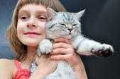Child with a cat — Stock Photo