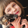 Happy little girl with a cat — Stock Photo #20691771