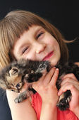 Happy little girl with a cat — Stock Photo