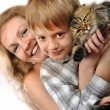 Happy mother and son with a cat — Stock Photo