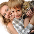 Happy mother and son with a cat — Stock Photo #21076783