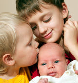Two brothers and baby sister — Stock Photo