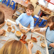 Group of children shaping clay in pottery studio - Stock Photo