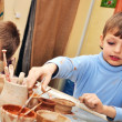 Children shaping clay in pottery studio — Stock Photo #21082791