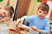 Children shaping clay in pottery studio — Stock Photo