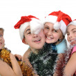 Group of happy friends celebrating Christmas — Stock Photo #22981460