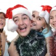 Group of happy children celebrating Christmas - Stock Photo