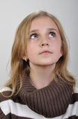 Portrait of a elementary girl looking up — Stock Photo