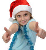 Child wearing a Santa hat with thumbs up — Stock Photo