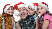 Group of happy children celebrating Christmas — Stock Photo