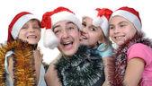 Group of happy children celebrating Christmas — Stock Photo