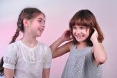 Happy laughing girls talking and having fun — Stock Photo