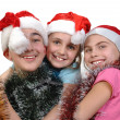 Group of happy friends celebrating Christmas - Stock Photo