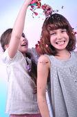 Two joyful children playing and having fun — Стоковое фото
