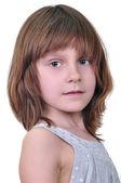 Elementära ålder tjej tittar på kameran — Stockfoto