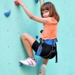 Child climbing up the wall — Stock Photo #29026589