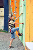 Child climbing up the wall — Stock Photo