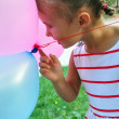 Adorable little girl playing with balloons — Stock Photo