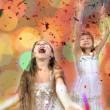 Happy children against bright background — Stock Photo