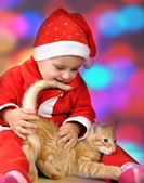 Christmas portrait of a child with a cat — Stock Photo