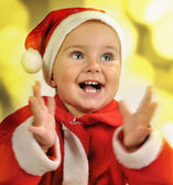 Christmas portrait of a child clapping hands — Stock Photo