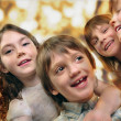 Holiday portrait of happy children against bright golden backgro — Stock Photo