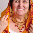 Senior woman in traditional Indian clothing and jeweleries — Stock Photo