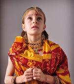 Little girl in traditional Indian sari and jeweleries — Stock Photo