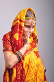 Little girl in traditional Indian clothing dancing — Stock Photo