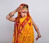 Child in traditional Indian clothing and jeweleries dancing — Stock Photo