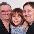 Portrait of a grandchild with grandparents — Stock Photo