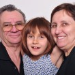 Stock Photo: Portrait of a grandchild with grandparents