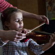 Adorable little girl learning violin playing — Stock Photo #44460727