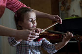 Adorable little girl learning violin playing — Stock Photo