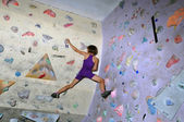 Child exercising at bouldering gym — Stock Photo