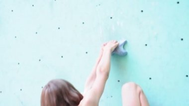 Girl exercising at the bouldering gym — Stockvideo
