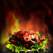 Grilled chicken over salad on the wooden desk — Stok fotoğraf