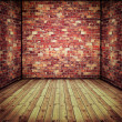 Abstract interior with old brick wall and wooden floor — Stock Photo